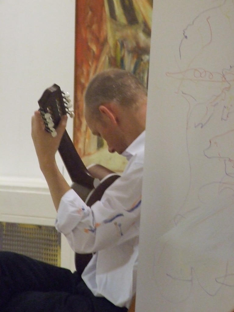 Large drawing and Puetro Rican guitar